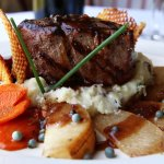 Grilled Filet Mignon feta cheese gratinée, green peppercorn & shallot reduction, potato-parsnip