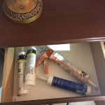 caulk gun and caulk left in nightstand by workers