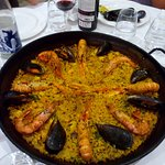 The famous seafood paella (for 4) and the bobal wine in he background