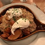 Biscuits and gravy with home fries and poached eggs