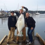 Proud young man with his first halibut. 40+ pounder.