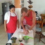 Maria showing my husband how to make a perfect lime pie!