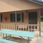 Each kitchen cabin has a porch and picnic table