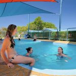 Blue Skyes people enjoying there time in the heated pool.