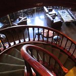 The spiral staircase down to the lower level.