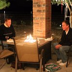 Husband and brother-in-law enjoying a conversation over wine, dinner, & dessert by the firepit.