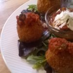 Our delicious arancini balls and our spicy tomato dip