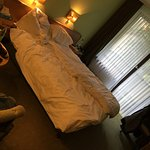 Tiny dark room with insanely soft bed.
