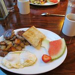 2 eggs with sausage, potatoes, toast and fruit