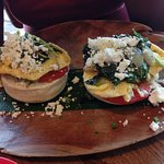 Muffins with sauteed spinach and eggs and tomatoes ans feta