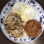 Two fried eggs. fried rice and corned beef patty. $11 including bottomless coffee!
