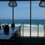 view from table toward surf beach