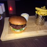 Nicely presented burger and chips in the bar/dining room
