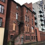 The parochial house located directly at the back of the church, in Pilot Street. There was a con