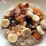 loaded oatmeal with peaches, bananas, cinnamon and more