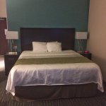 Comfy bed and sitting area in the room. Breakfast was delicious. I love that the thermostat is n
