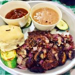 Ground Chuck Steak with mushrooms, a biscuit, cowboy beans, zucchini & gravy