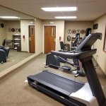 Exercise room offers full-length mirrored wall.