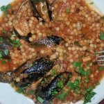 Fregola and mixed seafood