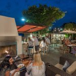 Dine outdoors in our cobblestone space with a relaxing water pool and glimmering lights.