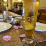 rose petals on the table and an ice cold beer