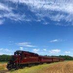 Excursion train traveling through None Such Farm in Buckingham Valley, Pennsylvania