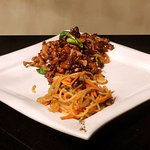 Dried beef served with pickled chili noodles