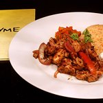 Stir fried chicken and vegetables served with garlic rice
