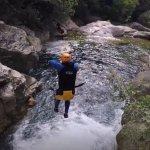 Crazy jumps into the rapids below.