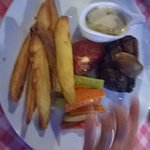 Fillet steak with mushroom sauce, potato wedges and seasonal veg