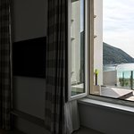 Desideria Room; window and door opening to Terrace and looking out the Lake Garda.