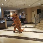 A T-Rex getting down with the DJ speakers in the lobby at DragonCon '17.