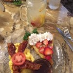Dutch Baby oven pancake with Scrambled Eggs served with fresh fruit and herb water