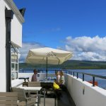 outdoor dining terrace overlooks the harbour and Sound of Mull
