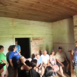 tour group inside small slave cabin