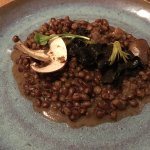Fermented red wheat with raw button mushrooms and sautéed black trumpet mushrooms at Eska.