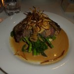 steak with mushroom and blue cheese sauce with greens