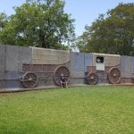 Wall of Ox wagons form a wall outside the Museum