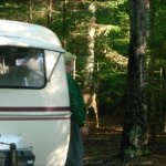 Here I am with deer and my little camper