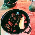 Mussels in white wine sauce and garlic. Drink: Rainbow Cocktail