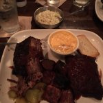 Beef rib, burnt ends, baby back ribs, cheesy corn and cole slaw.