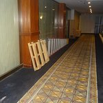 PALLETS AND LADDERS LEFT IN HALLWAY