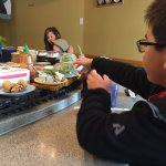 Grabbing edamame off the sushi train