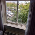 Buckled window frames, with view onto parking lot, for $500/night!