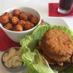 The Alabamian Hamburger on a lettuce bowl with sweet potato tater tots.