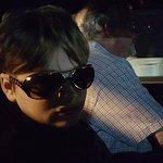 Priceless photo of my son in a pink Cadillac limo with new Elvis sunglasses purchased for $10.
