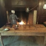 A young madien cooking boiled dinner for the militia men...