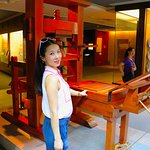 My wife with the first printing press in Macau.