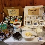 items for breakfast - jams and different types of honey with cheeses and seeds