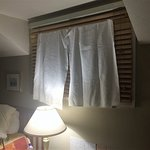 Towels over blinds to block the light
